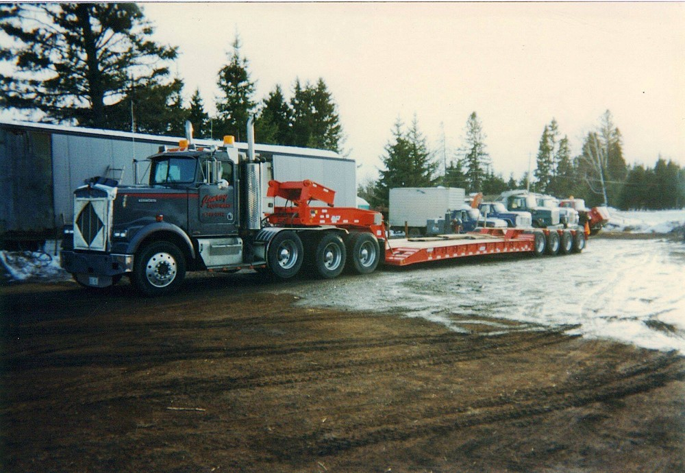 Jonroy Equipment Rentals - Tractor and new lowbed in 1996